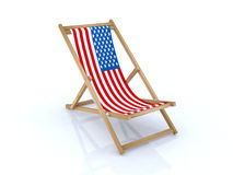 Wood beach chair with american flag Stock Photo