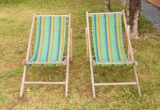 Wood beach chairs on grass Stock Photo