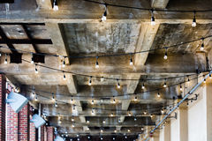 Wood beam ceiling hanging lights. Wood beam ceiling roof hanging outdoor string Stock Photos