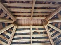 Wood beams in ceiling of shed with nests. Wood beams in ceiling of shed with bird nests royalty free stock photos