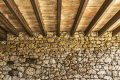 Wood beams perspective on a rock wall Royalty Free Stock Photography