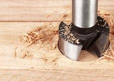 Wood bearbeta, avfallsspiralborrande, slut upp Royaltyfri Bild