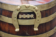 Wood beer keg with horseshoe. A wooden beer keg with the word BEER written and an upside down horseshoe Royalty Free Stock Images