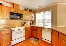 Wood and beige walls American standart kitchen. Royalty Free Stock Images