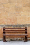Wood bench. Against a brick wall royalty free stock image