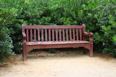 Wood Bench. Wooden bench in a park stock photo