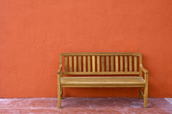 Wood Bench Against blank Wall. Stock Photos