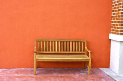 Wood Bench Against blank Wall. Stock Photography