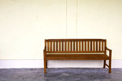 Wood Bench Against blank Wall. Stock Image