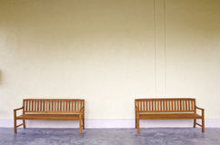 Wood Bench Against blank Wall. Royalty Free Stock Photography