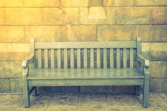 Wood Bench against concrete wall .  ( Filtered image processed v Royalty Free Stock Images