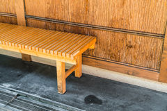 Wood Bench Against wood Wall . Stock Photos