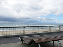 Wood bench with the beach. Background Stock Photo
