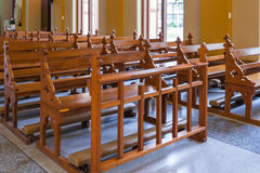 Wood Bench of Catholic church, people can pray for god jesus Royalty Free Stock Images