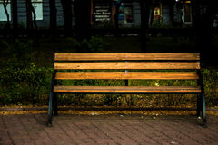 Wood bench. In a city park stock photos