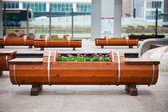 Wood Bench and Flowerbed Stock Photo