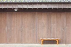Wood bench in front of Old japanese shop house Stock Photography