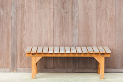 Wood bench. In front of wooden house stock photos