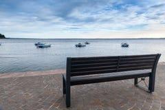 Wood bench at the Garda lake Royalty Free Stock Photography