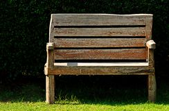 Wood bench in garden Stock Images