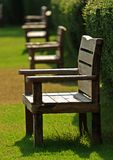 Wood bench in garden Stock Photo
