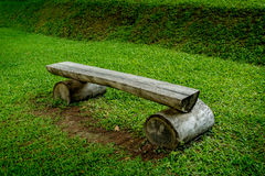 Wood bench on green grass Royalty Free Stock Image