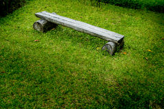 Wood bench on green grass Royalty Free Stock Photo