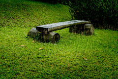 Wood bench on green grass Stock Photo