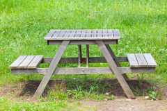 Wood bench at green park in summer Royalty Free Stock Images