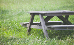 Wood bench at green park in summer Stock Photography