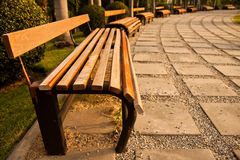 Wood bench in park Stock Image
