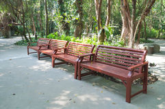 Wood bench in the park. Row of four brown wood benches in the park Stock Image