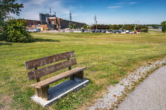 Wood bench. Public wood bench in front of a bicycle path stock images