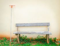 Wood bench with rake Royalty Free Stock Photo