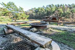 Wood bench, table and outdoor bbq. In a swedish lake surrounded by rocks and forest stock images