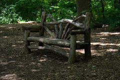 Wood bench under the shade Royalty Free Stock Images