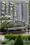 Wood bench with vertical garden Stock Photography