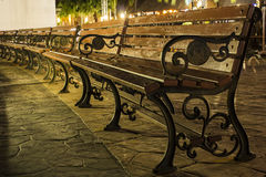 Wood Benches in the park at night Stock Images