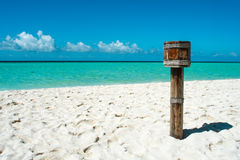 Wood bin on maldives beach Royalty Free Stock Image
