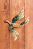 Wood bird carved on wooden board. Picture stock photography