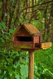 Wood bird house. In the woods part of the Cerco garden in Mafra, Portugal stock photography