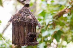 Wood birdhouse in the forest royalty free stock photo