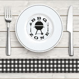 Wood Black Checked Cloth Knife Fork Plate BBQ Zone. Knife, fork and plate with black checked table cloth on the wooden background Stock Images