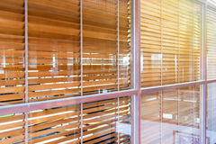 Wood blind behind the glass window Royalty Free Stock Photos