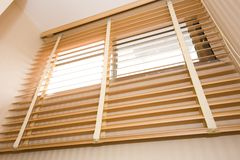 Wood blinds. Home interior detail for wooden blinds royalty free stock photos