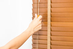 Wood blinds closed by hand. Royalty Free Stock Photo
