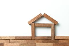 Wood block as house for real estate theme royalty free stock photography