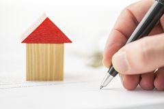 Wood block building and hand writing Stock Photo