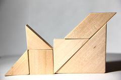 Wood Block Puzzle. Building blocks towering high, shows height, symbolic of stability, teamwork Stock Image