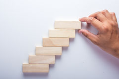Wood block stacking as step stair, Business concept for growth success process.  Royalty Free Stock Image